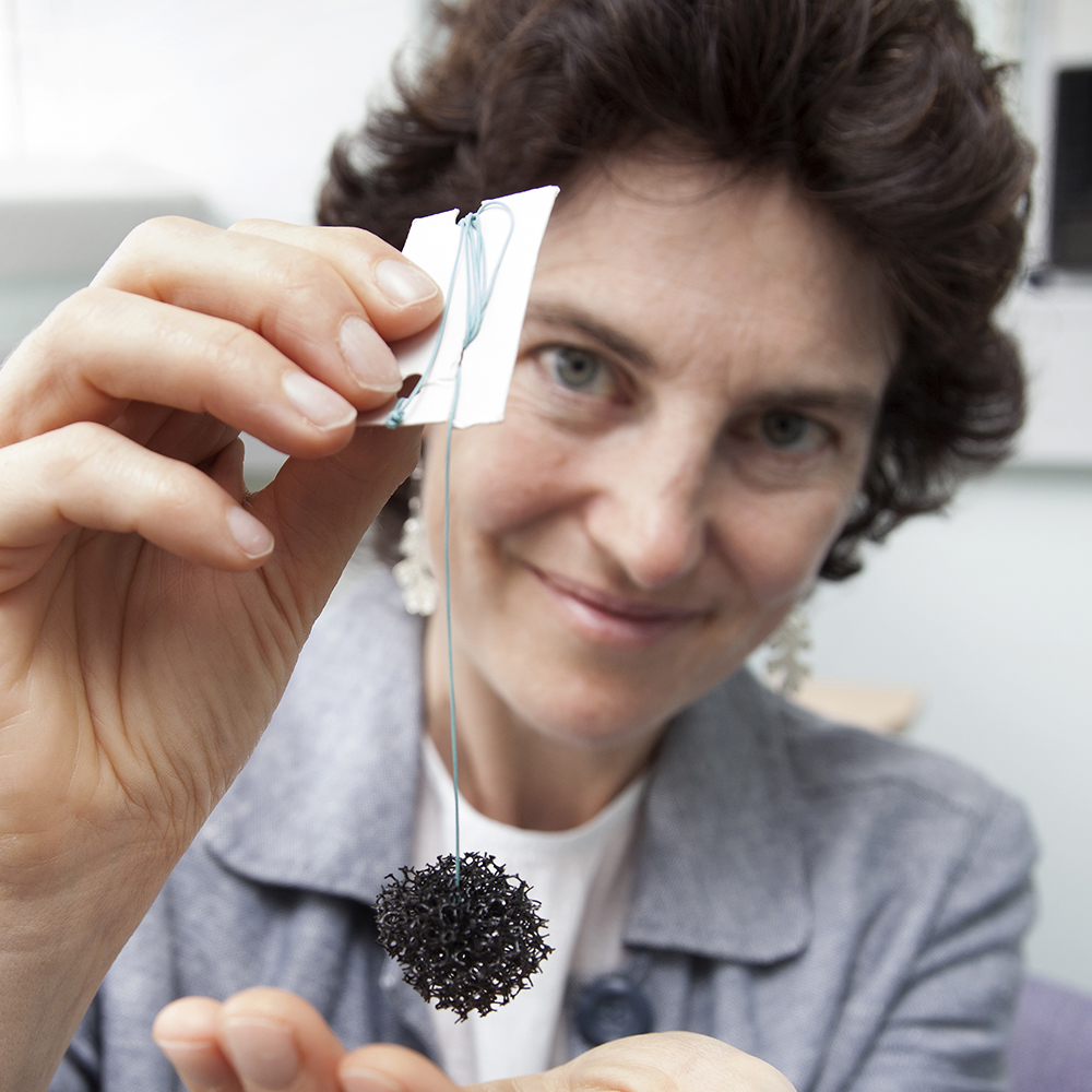 Professor Rebecca Fitzgerald holds up an expanded Cytosponge
