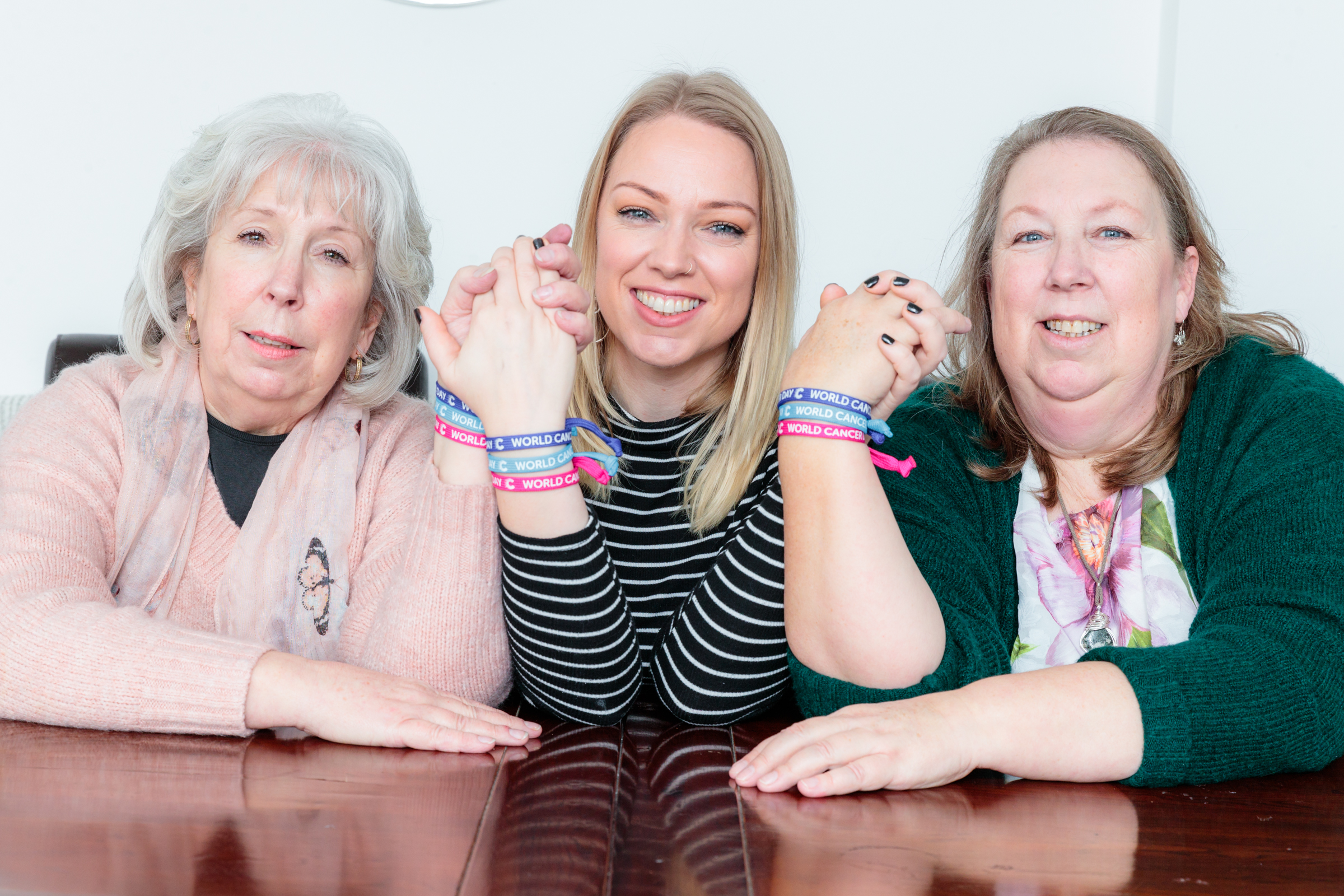 L-R Gail, Becky and Debbie wear Unity Bands to support World Cancer Day