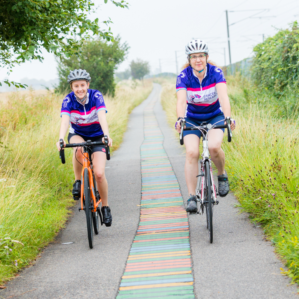 Dr Helen Mott (right) with PhD student Jasmine Cornish cycling on the DNA path between Addenbrooke's and Shelford.