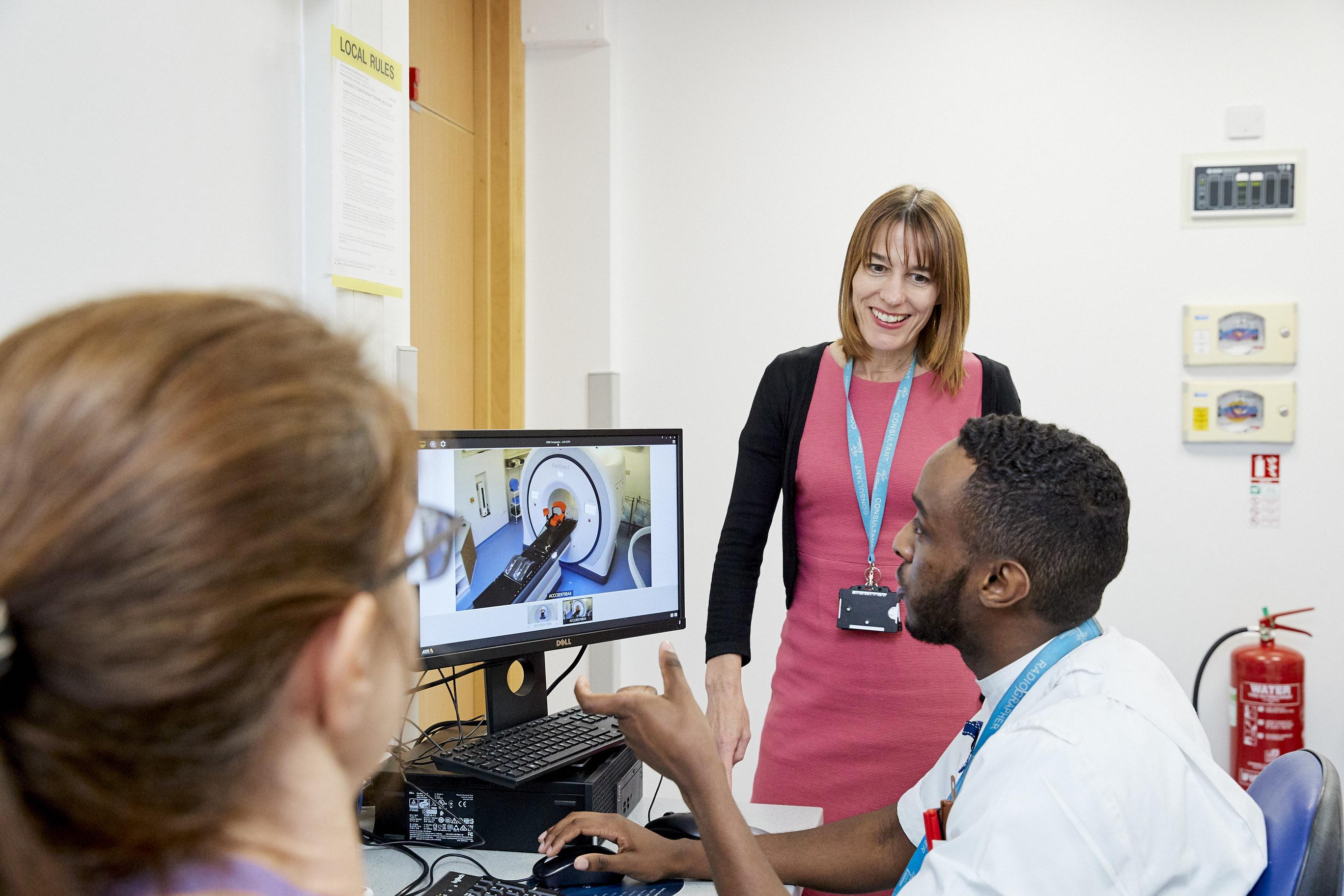 Professor Charlotte Coles (centre) CRUK RadNet Cambridge lead, with colleagues
