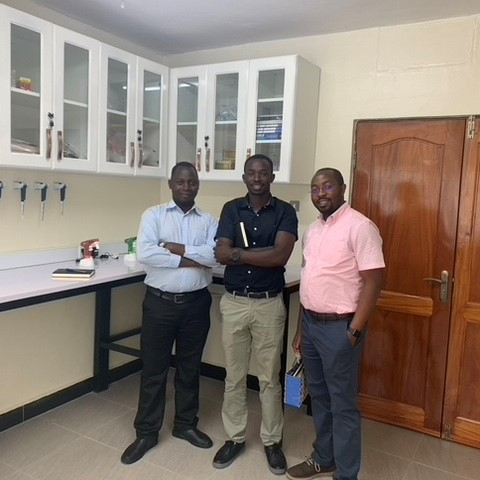 The lab at the UCI with technician Sylivester Kadhumbula, Ezra Anecho and director of research Nixon Niyonzima.