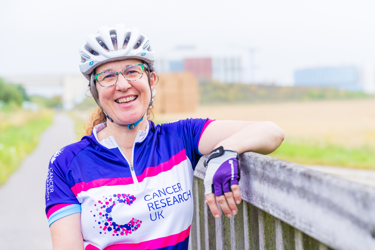Dr Helen Mott getting on her bike to promote Cancer Research UK's Cycle 300 fundraising initiative.