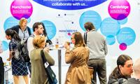 The CRUK Cambridge and Manchester Centres exhibition stand at the NCRI conference in Liverpool