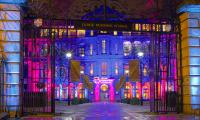 Cambridge Judge Business School illuminated in Cancer Research UK colours